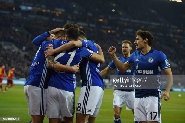 Schalke's Austrian midfielder Alessandro Schoepf celebrates scoring the first goal with his teammates during the German first division Bundesliga...