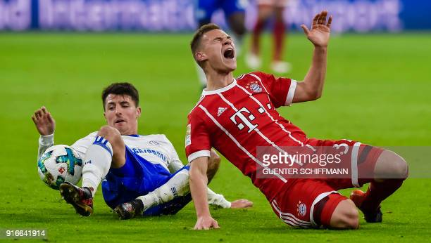 Schalke's Austrian midfielder Alessandro Schoepf fouls Bayern Munich's German midfielder Joshua Kimmich during the German first division Bundesliga...