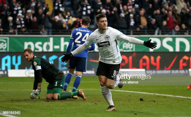 Schalke's Bastian Oczipka and goalkeeper Ralf Faehrmann watch in vain while Frankfurt's Luka Jovic celebrates his 10 goal during the German...