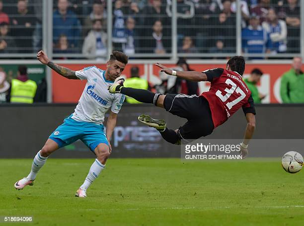 Schalke's Brazilian defender Junior Caicara fouls Ingolstadt's striker Dario Lezcano during the German first division Bundesliga football match FC...