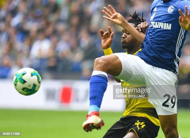 Schalke's Brazilian defender Naldo and Dortmund's Belgian striker Michy Batshuayi vie for the ball during the German first division Bundesliga...