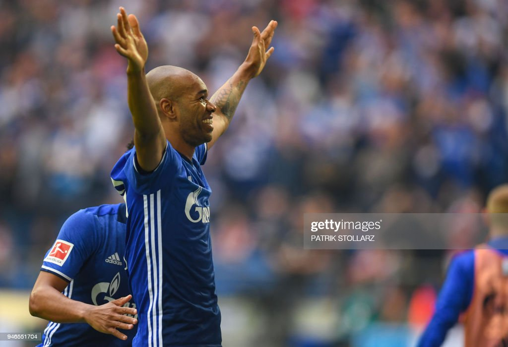 Schalke's Brazilian defender Naldo celebrates scoring during the German first division Bundesliga football match FC Schalke 04 vs Borussia Dortmund, in Gelsenkirchen, western Germany, on April 15, 2018. / AFP PHOTO / Patrik