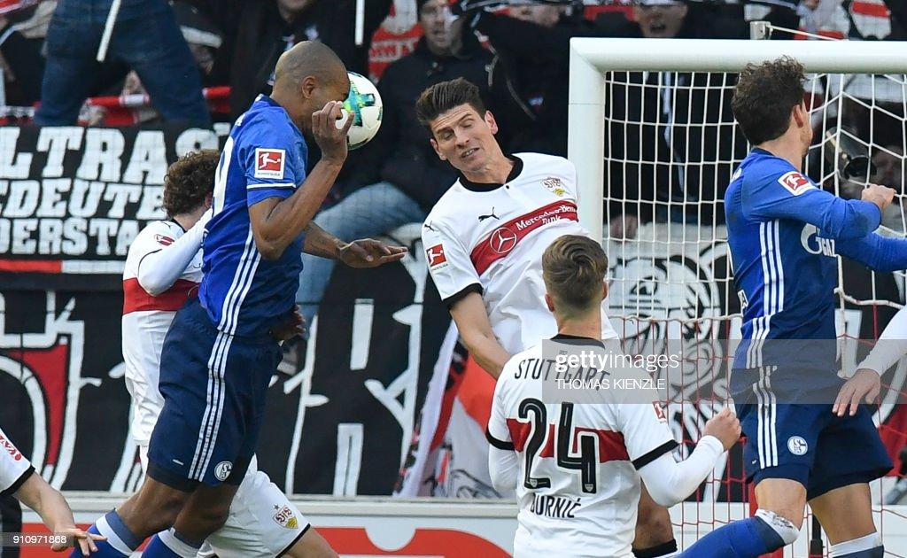 Schalke's Brazilian defender Naldo (2ndL) heads the ball before scoring the opening goal during the German first division Bundesliga football match VfB Stuttgart vs Schalke 04 in Stuttgart, southwestern Germany, on January 27, 2018. /