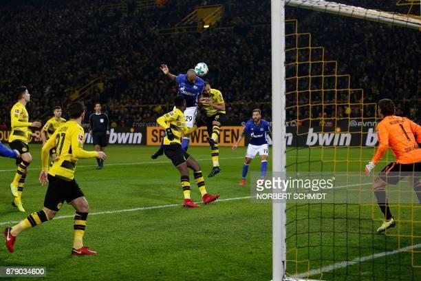 Schalke's Brazilian defender Naldo heads the ball to score despite of Dortmund's German goalkeeper Roman Weidenfeller during the German First...