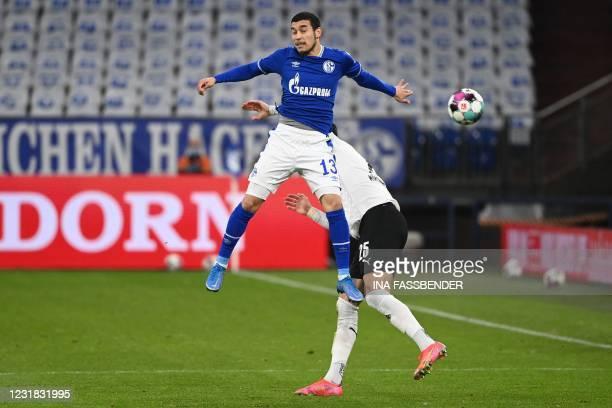 Schalke's Brazilian defender William de Asevedo Furtado and Moenchengladbach's Algerian defender Ramy Bensebaini vie for the ball during the German...