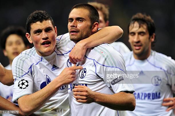 Schalke's Brazilian striker Edu celebrates with team mate Greek defender Kyriakos Papadopoulos after scoring against Inter Milan during their UEFA...