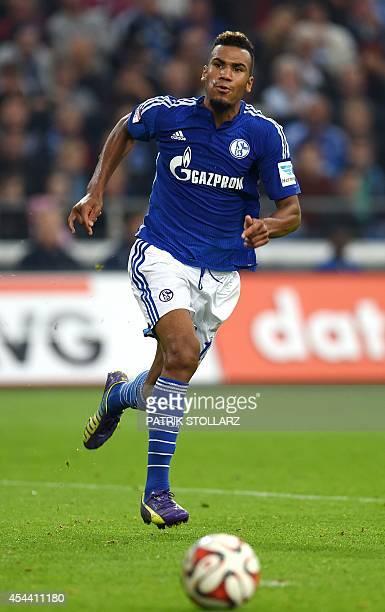 Schalke's Cameroon forward Eric Maxim ChoupoMoting plays the ball during the German first division Bundesliga football match Schalke 04 vs Bayern...
