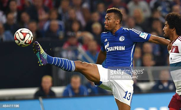 Schalke's Cameroon forward Eric Maxim ChoupoMoting vies for the ball during the German first division Bundesliga football match Schalke 04 vs Bayern...