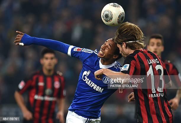 Schalke's Cameroonian defender Joel Matip and Frankfurt's midfielder Martin Lanig vie for the ball during the German first division Bundesliga...