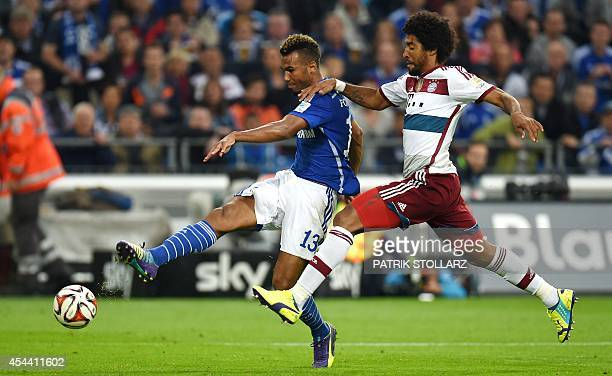 Schalke's Cameroonian forward Eric Maxim ChoupoMoting and Bayern Munich's Brazilian defender Dante vie for the ball vie for the ball during the...