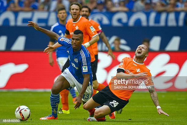 Schalke's Cameroonian forward Eric Maxim ChoupoMoting and Darmstadt's defender Konstantin Rausch vie for the ball during the German first division...