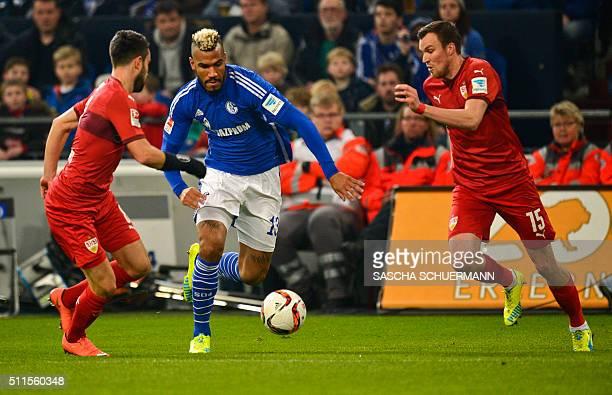 Schalke's Cameroonian forward Eric Maxim ChoupoMoting and Stuttgart's midfielder Lukas Rupp and Stuttgart's defender Kevin Grosskreutz vie for the...