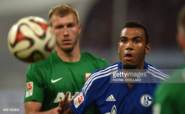 Schalke's Cameroonian forward Eric Maxim ChoupoMoting plays the ball during the German First division Bundesliga football match FC Schalke 04 vs FC...