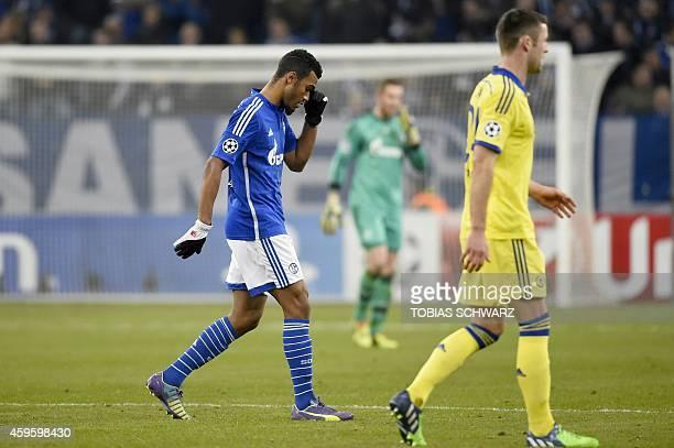 Schalke's Cameroonian forward Eric Maxim ChoupoMoting reacts during the UEFA Champions League second leg Group G football match FC Schalke 04 vs...