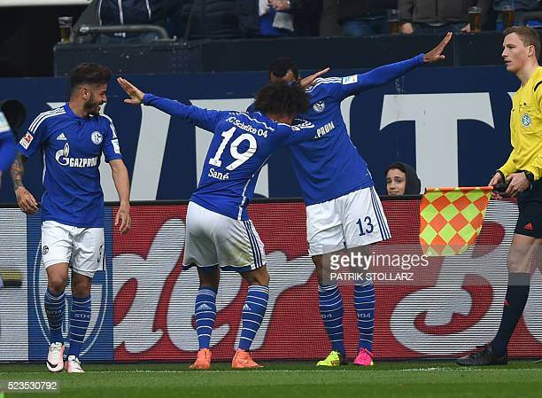 Schalke's Cameroonian forward Eric Maxim Choupo-Moting , Schalke's midfielder Leroy Sane and Schalke's Brazilian defender Junior Caicara celebrate...