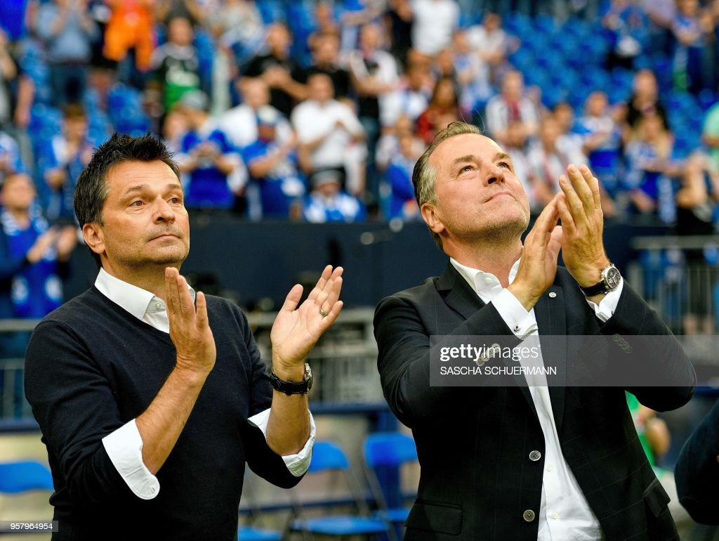 Schalke's chairman of the board Clemens Toennies (R) and manager Christian Heidel (L) applaud after the German first division Bundesliga football match FC Schalke 04 vs Eintracht Frankfurt in Gelsenkirchen, western Germany, on May 12, 2018. (Photo by SASCHA SCHUERMANN / AFP)