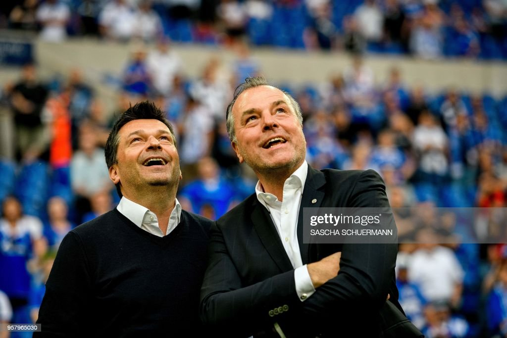 Schalke's chairman of the board Clemens Toennies (R) and manager Christian Heidel (L) are pictured after the German first division Bundesliga football match FC Schalke 04 vs Eintracht Frankfurt in Gelsenkirchen, western Germany, on May 12, 2018. (Photo by SASCHA SCHUERMANN / AFP)
