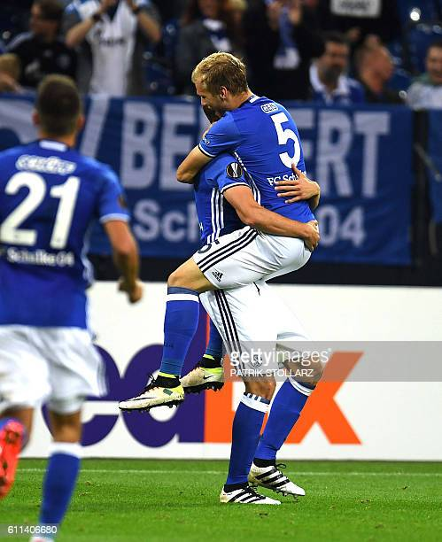 Schalke's defender Benedikt Hoewedes and his teammates celebrate during the UEFA Europa League firstleg football match between Schalke 04 and FC...