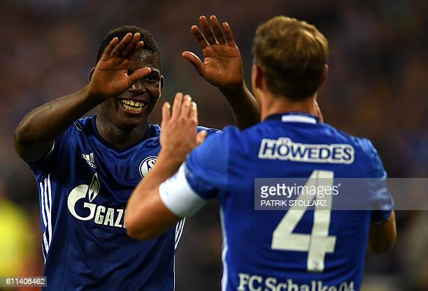 Schalke's defender Benedikt Hoewedes and Schalke's Swiss midfielder Breel Embolo celebrate scoring during the UEFA Europa League firstleg football...