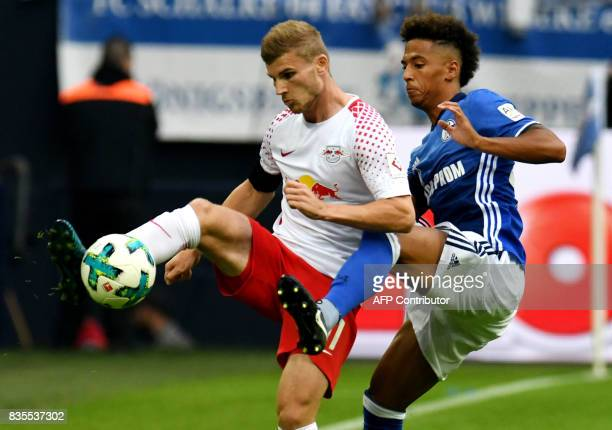 Schalke's defender Thilo Kehrer and Leipzig´s striker Timo Werner vie for the ball during the German First division Bundesliga football match FC...