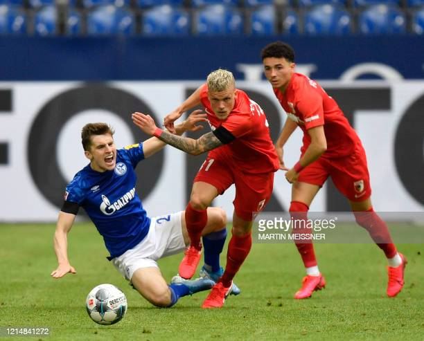 Schalke's English defender Jonjoe Kenny vies for the ball with Augsburg's German defender Philipp Max during the German first division Bundesliga...