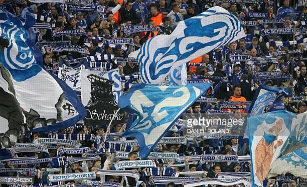 Schalke's fans celebrate their team prior to the UEFA Champions League quarter final second leg football match Schalke 04 vs Inter Milan in...