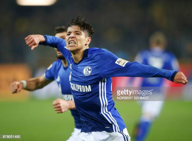 Schalke's French midfielder Amine Harit celebrates after scoring a goal during the German First division Bundesliga football match between Borussia...