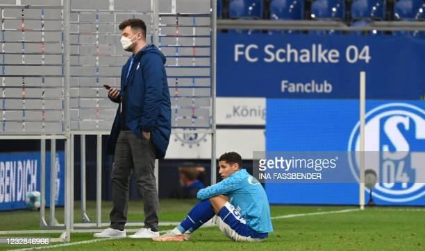 Schalke's French midfielder Amine Harit reacts after the German first division Bundesliga football match FC Schalke 04 v Hertha Berlin on May 12,...