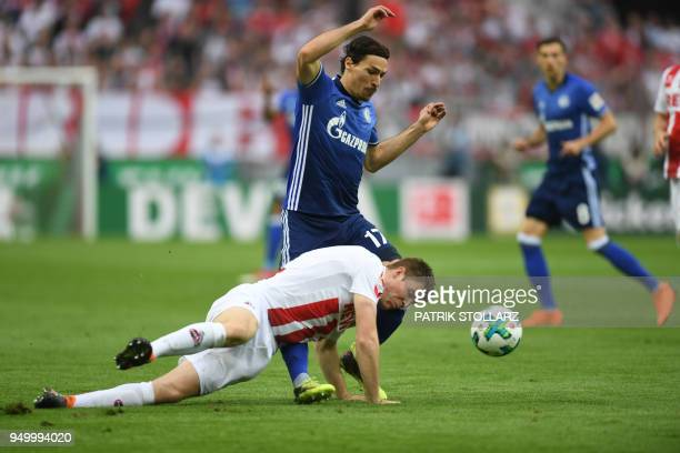 Schalke's French midfielder Benjamin Stambouli and Cologne's German defender Dominique Heintz vie for the ball during the German first division...