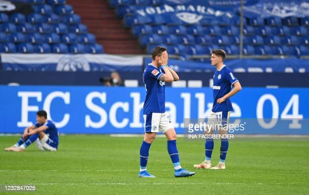 Schalke's German defender Bastian Oczipka reacts after the German first division Bundesliga football match FC Schalke 04 v Hertha Berlin on May 12,...