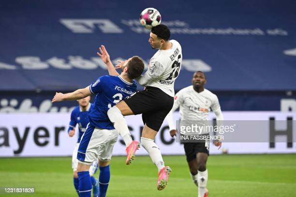 Schalke's German defender Shkodran Mustafi and Moenchengladbach's Algerian defender Ramy Bensebaini vie for the ball during the German first division...