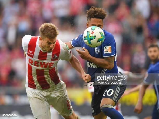 Schalke's German defender Thilo Kehrer and Cologne's German midfielder Simon Terodde vie for the ball during the German first division Bundesliga...