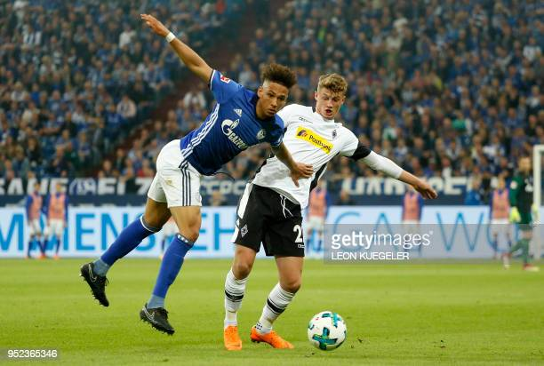 Schalke's German defender Thilo Kehrer and Moenchengladbach's French midfielder Mickael Cuisance vie for the ball during the German first division...