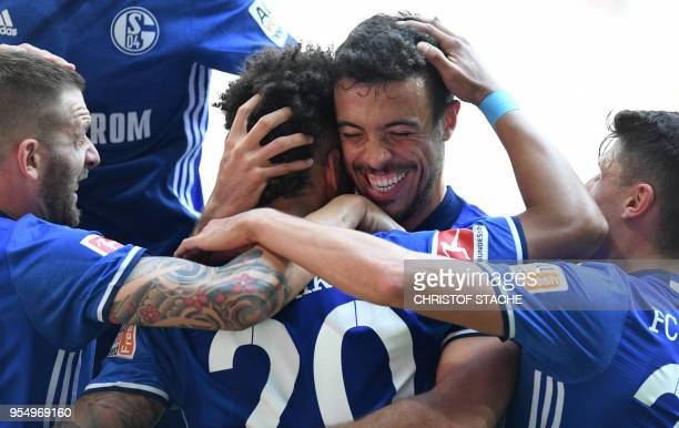 Schalke's German defender Thilo Kehrer is congratulated by Schalke's Argentinian strider Franco di Santo after scoring the first goal during the...