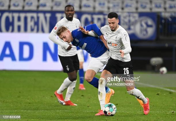 Schalke's German defender Timo Becker and Moenchengladbach's German goalkeeper Max Gruen vie for the ball during the German first division Bundesliga...