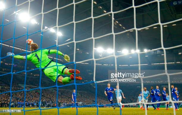 Schalke's German goalkeeper Ralf Faehrmann can't stop a goal by Manchester City's German midfielder Leroy Sane during the UEFA Champions League round...