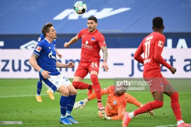 Schalke's German goalkeeper Ralf Faehrmann vies for the ball with Hertha Berlin's Serbian midfielder Nemanja Radonjic during the German first...