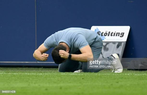 Schalke's German headcoach Domenico Tedesco celebrates after the German first division Bundesliga football match FC Schalke 04 vs Borussia Dortmund...