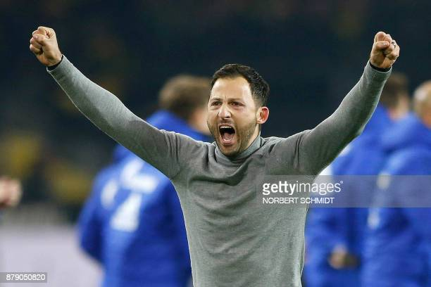 Schalke's German headcoach Domenico Tedesco celebrates at the end of the German First division Bundesliga football match between Borussia Dortmund...