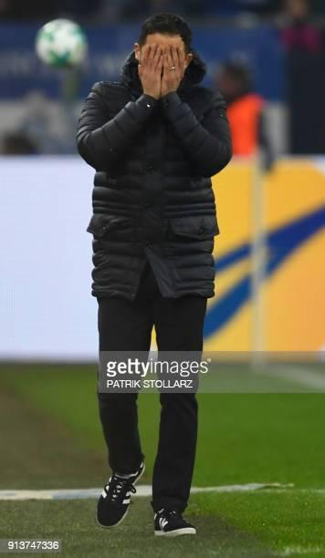 Schalke's German headcoach Domenico Tedesco reacts during the German first division Bundesliga football match FC Schalke 04 vs Werder Bremen in...