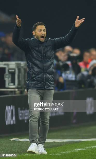 Schalke's German headcoach Domenico Tedesco reacts during the German first division Bundesliga football match FC Schalke 04 vs Hoffenheim in...