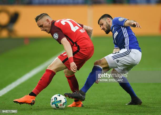 Schalke's German midfielder Daniel Caligiuri and Frankfurt's German midfielder Marius Wolf vie for the ball during the German Cup DFB Pokal semifinal...