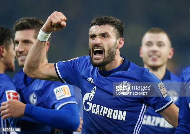 Schalke's German midfielder Daniel Caligiuri celebrates after scoring a goal during the German First division Bundesliga football match between...