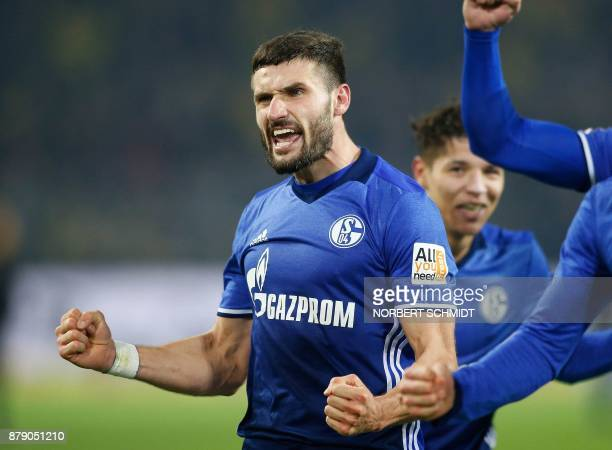 Schalke's German midfielder Daniel Caligiuri celebrates after scoring a goal during the German First division Bundesliga football match between...