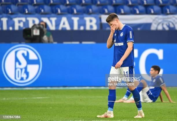 Schalke's German midfielder Florian Flick reacts after the German first division Bundesliga football match FC Schalke 04 v Hertha Berlin on May 12,...