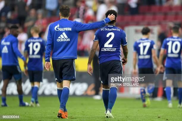 Schalke's German midfielder Leon Goretzka and Schalke's US midfielder Weston McKennie react after the German first division Bundesliga football match...