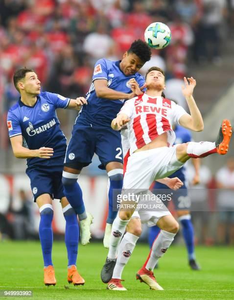 Schalke's German midfielder Leon Goretzka US midfielder Weston McKennie and Cologne's German midfielder Salih Ozcan vie for the ball during the...