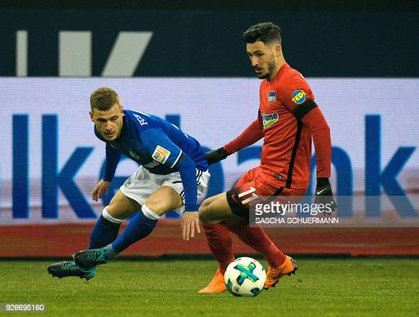 Schalke's German midfielder Max Meyer and Berlin's Australian midfielder Mathew Leckie vie for the ball during the German first division Bundesliga...