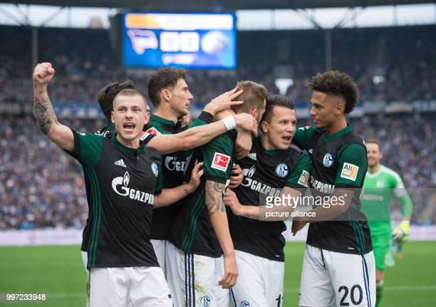 Schalke's goal getter Guido Burgstaller celebrates with his teammates Max Meyer Leon Goretzka Yevhen Konoplyanka and Thilo Kehrer after scoring the...