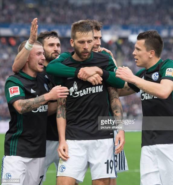 Schalke's goal getter Guido Burgstaller celebrates with his teammates Max Meyer Daniel Caligiuri Leon Goretzka and Yevhen Konoplyanka after scoring...